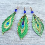 larger leather peacock feather pendants
