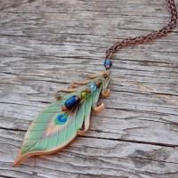 leather peacock pendant