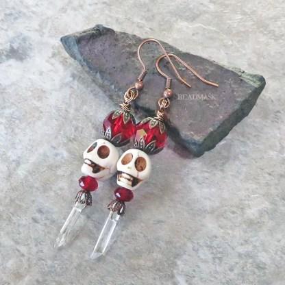 skull earrings with quartz crystal