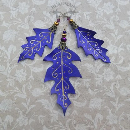 3 purple leather leaf ornaments