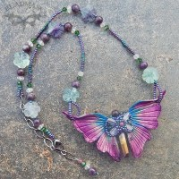 leather butterfly necklace in tourmaline hues