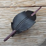 Leather crow feather ponytail holder with burgundy striped wood stick