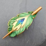 emerald leather peacock feather shawl pin