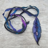 fantasy crow feather leather pendant with amethyst stones