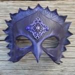 Purple crow jeweled leather mask.