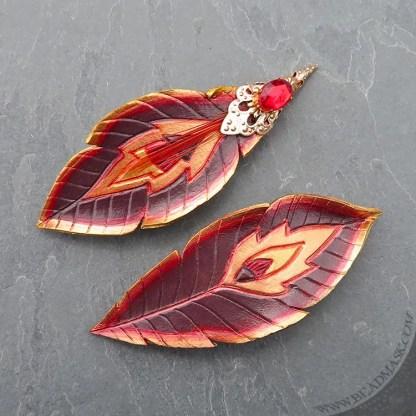 firebird feather leather barrettes