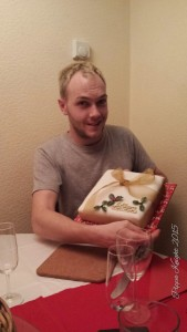 My Cousing showing off my Mothers decoration of Christmas Cake number 1!