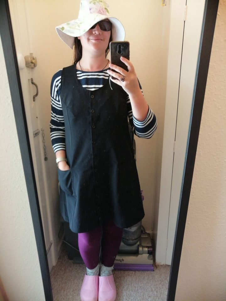 In the folds Button up dress in black 'canvas', purple leggings and a blue and white striped tee