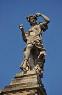 Marble statue atop the Teatro Nacional