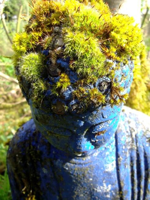 Buddha wears a crown of moss in the Bog Garden