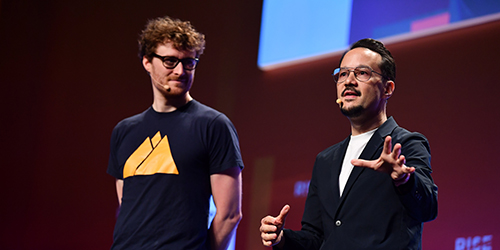 9 July 2019; Casey Lau, Co-Founder, Executive Director, StartupsHK, right, and Paddy Cosgrave, CEO & co-founder, Web Summit & RISE, on Centre Stage during day one of RISE 2019 at the Hong Kong Convention and Exhibition Centre in Hong Kong. Photo by Stephen McCarthy/RISE via Sportsfile