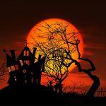 Orange ghost moon behind wonky house