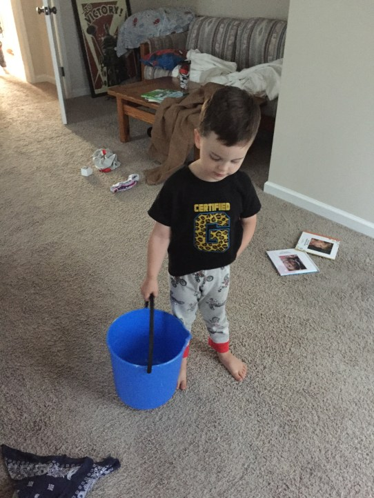 Cormac carrying around his throw up bucket