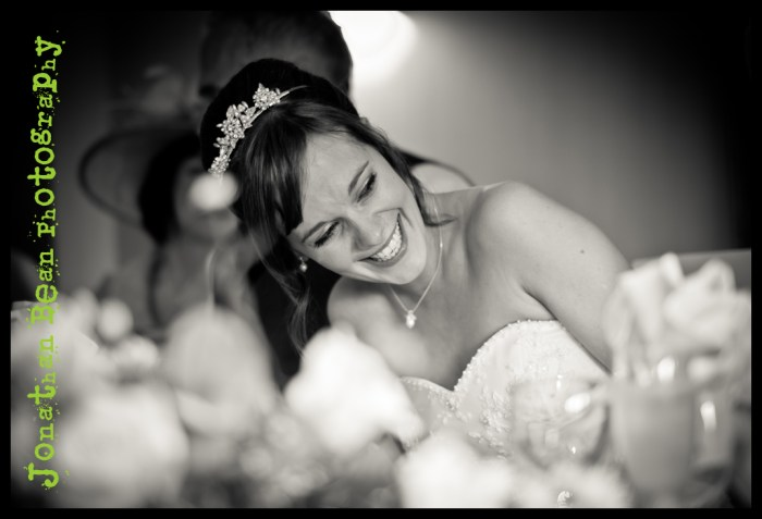 Bride laughing during wedding speeches