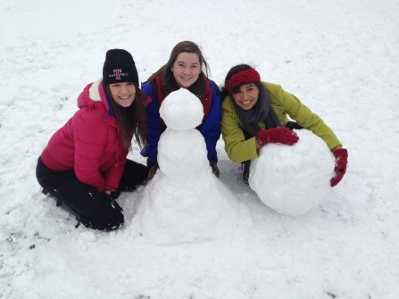 Students building snowmen and enjoying the snow while it's here!