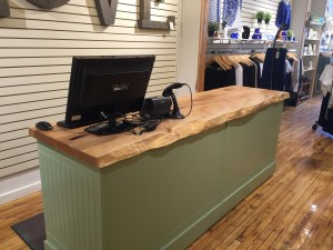 Custom retail checkout desk made using maple with live edge for Maggie Grace Boutique in Winnipeg