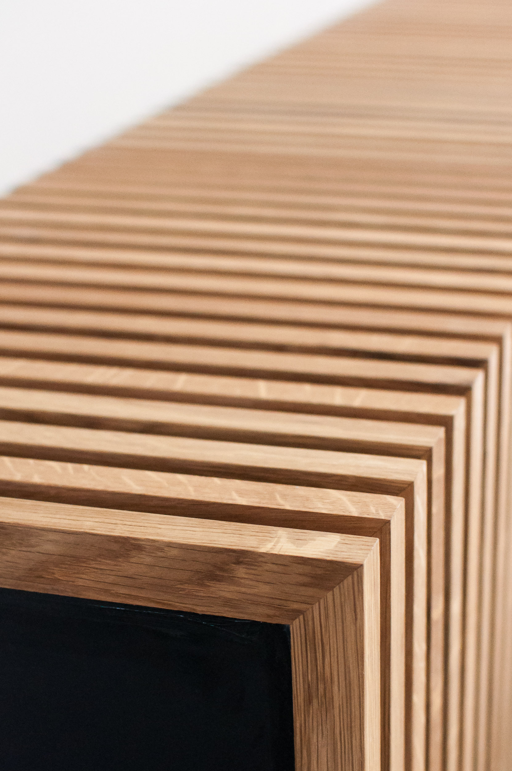 Close-Up of Custom White Oak Slats for Electric Fireplace in River Heights home in Winnipeg