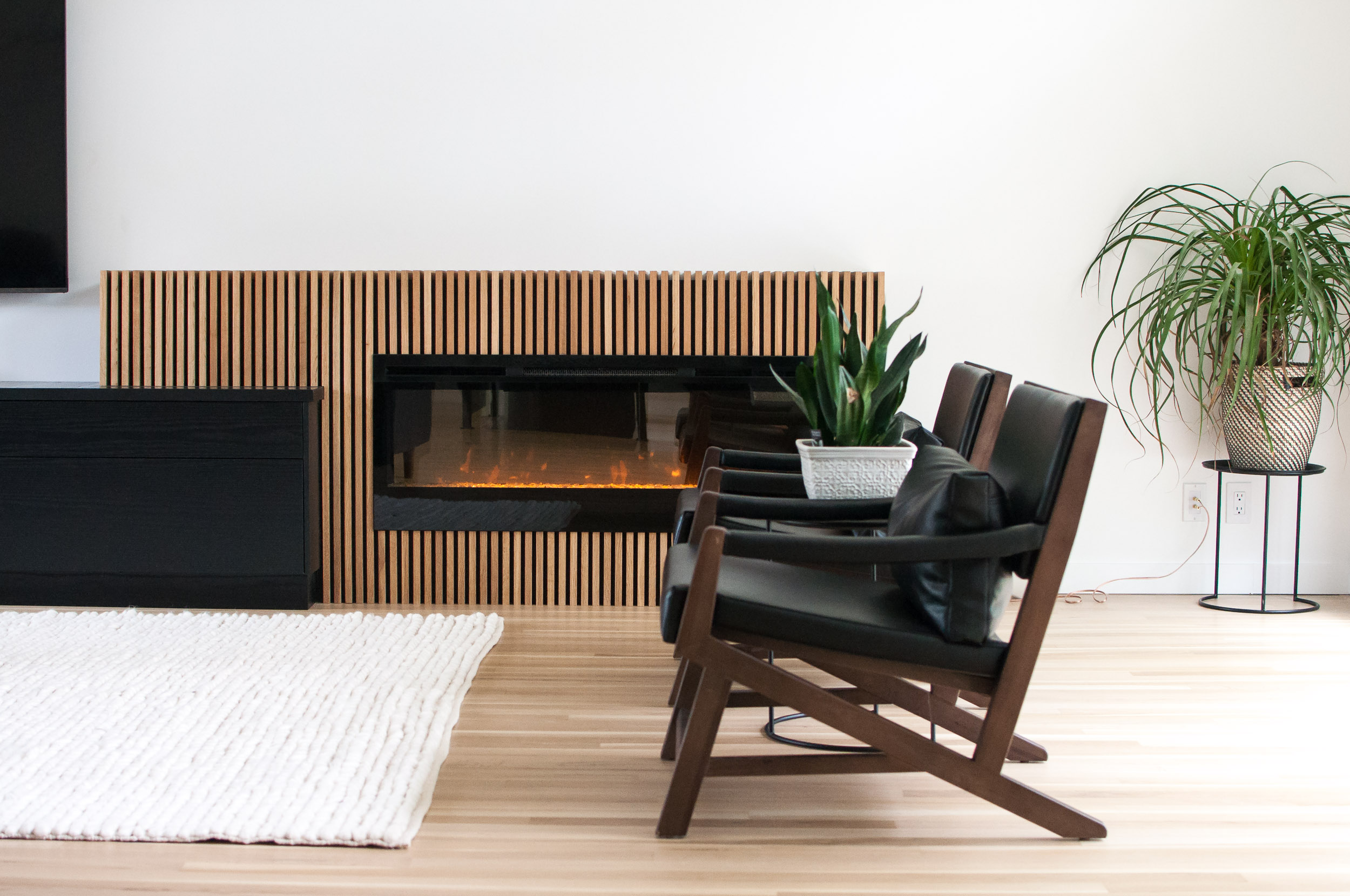 Beautiful Electric Fireplace with Custom White Oak Slats in River Heights, Winnipeg