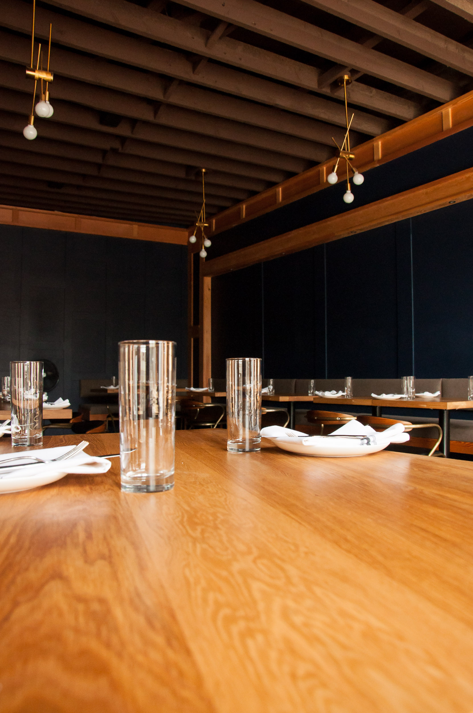 Close-up of custom table made with White Oak for The Oxbow Natural Wine Bar & Restaurant