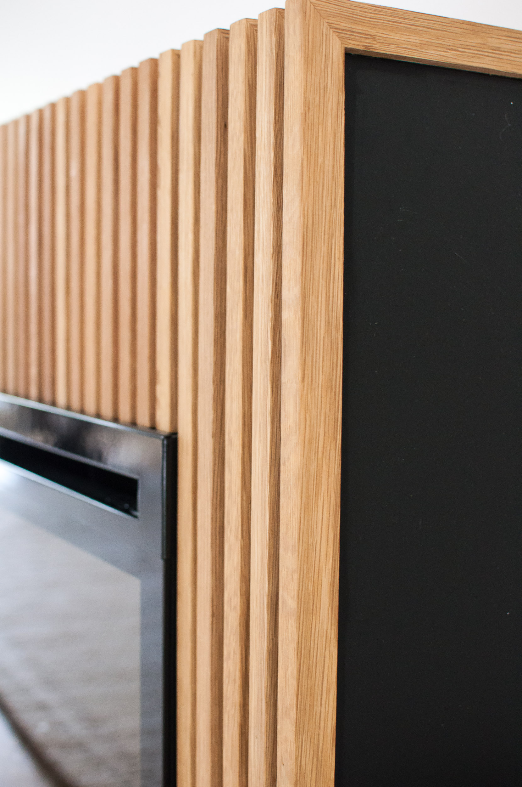 Another Close-Up of Custom White Oak Slats for Electric Fireplace in River Heights home in Winnipeg
