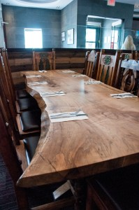 Custom-built table & steel base made with spalted maple with a live edge slab for Junction 59 Roadhouse