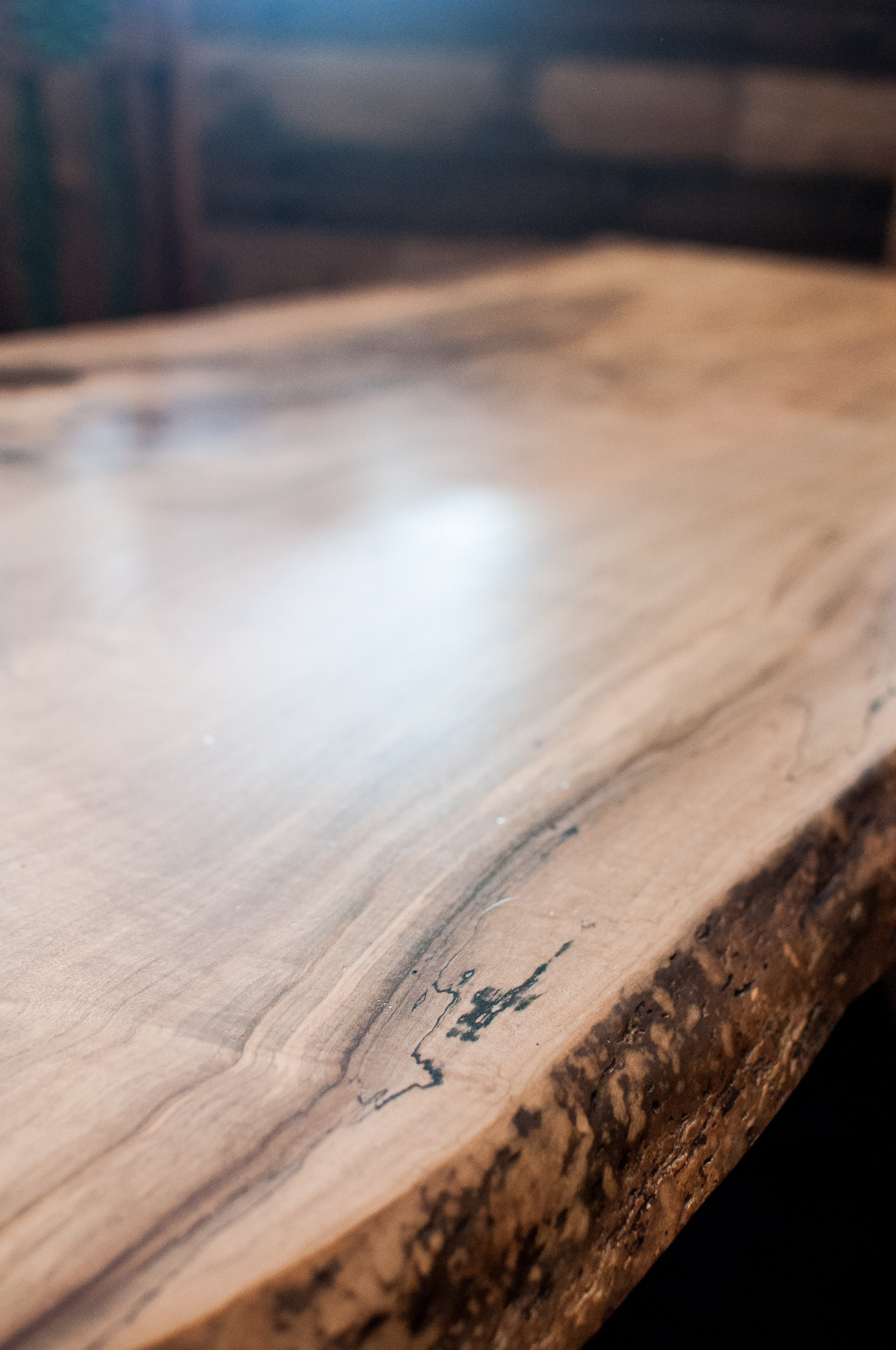 Close-up of live edge slab of Spalted Maple custom built table for Junction 59 Roadhouse