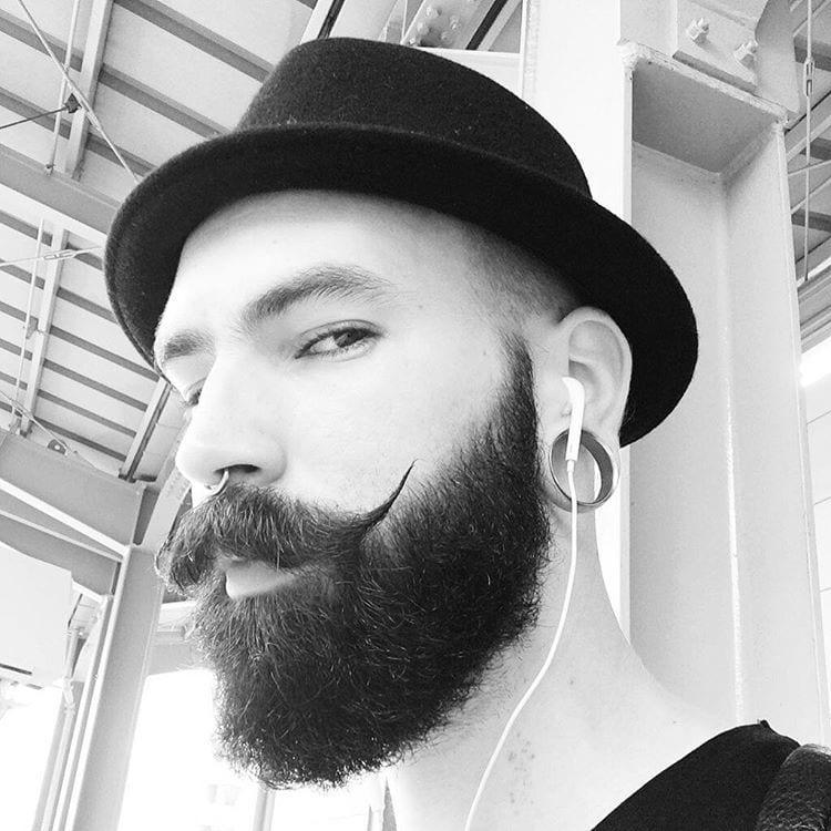 punk boy with handlebar mustache