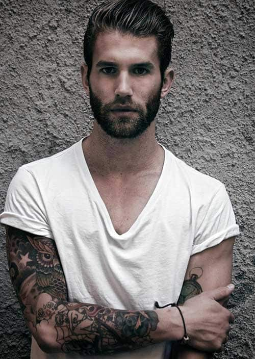 short groomed hairstyle with beard