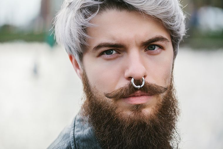 thick beard with pointed mustache