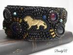 bracelet perles noires et lion