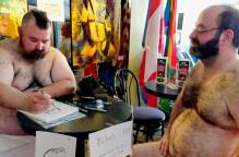 Steven drawing Eric's caricature.