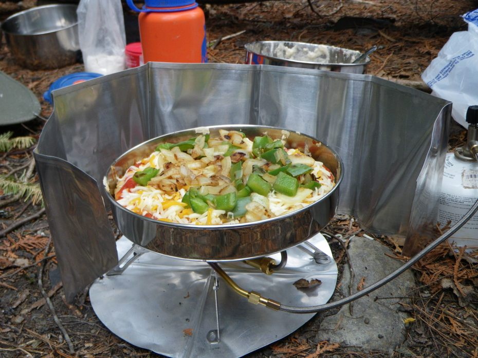 Camp food cooked on a bearskin stove