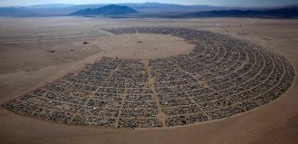 """More than 50,000 people from all over the world have gathered at the Burning Man 2011 """"Rites of Passage"""" arts and music festival in the Black Rock desert of Nevada. (Jim Urquhart/Reuters)"""