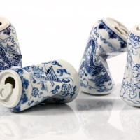 Smashed Porcelain Cans - by Lei Xue