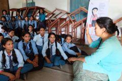 8 Oligaun Uma Bista teaching a girls group about photography