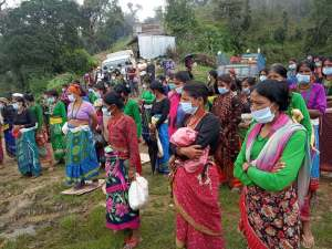 Women in Achham in the distribution of basic food
