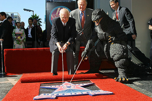 Johnny Grant awarding a star to Godzilla!