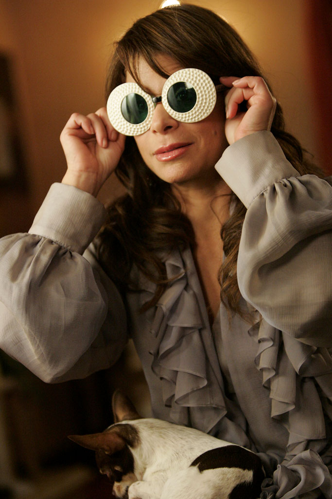 Paula Abdul hiding her tears with crazy shades...