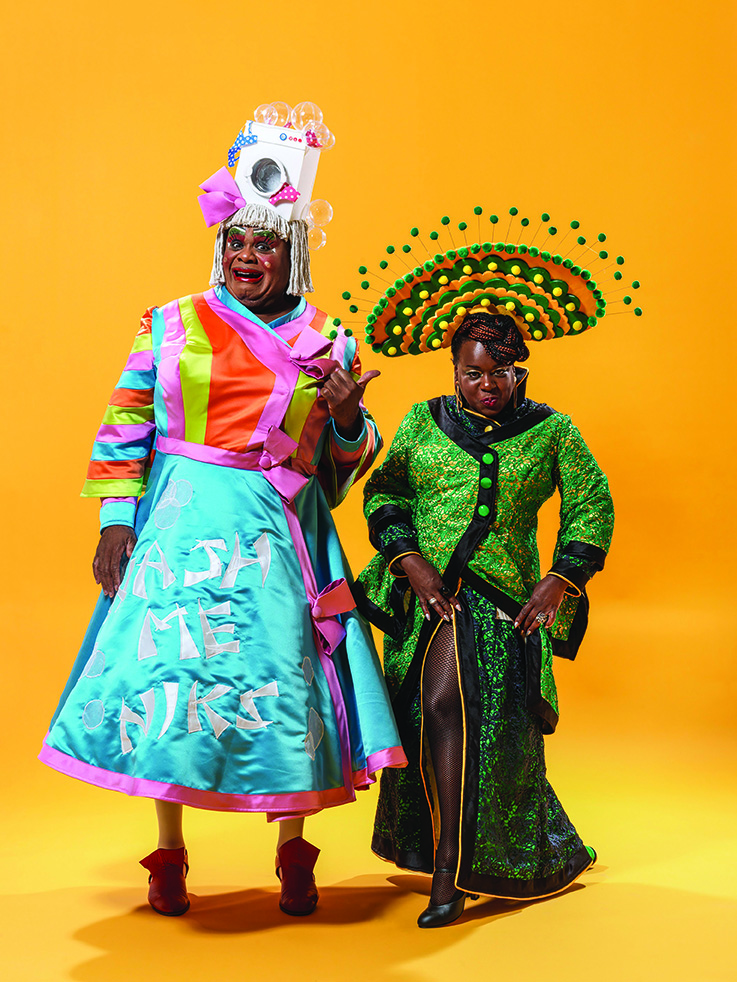 Aladdin-Clive-Rowe-as-Widow-Twankey-and-Tameka-Empson-as-The-Empress-in-Hackney-Empires-20th-anniversary-pantomime-Aladdin-2.-Credit-Perou.jpg