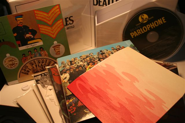 "All the original inserts are included - like the Sgt Pepper cut-out card and the ""psychodelic"" pink-coloured inner-sleeve"