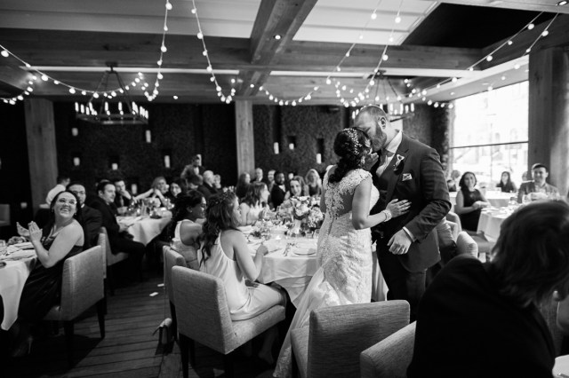 A bride and groom kiss at a wedding held at Ristorante Beatrice.