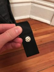 Represent! WordPress pins attached to the should straps.
