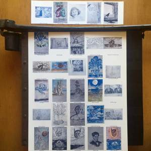 Image of contact sheet being cut on a paper cutter.