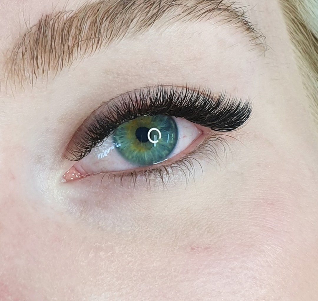 Beautiful lash extensions and green eyes