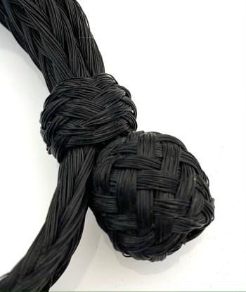 Detail of the knot on the black 25 strand bracelet.