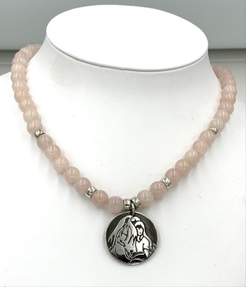 Rose quartz and Quiet Time pendant, as it would look on a person.