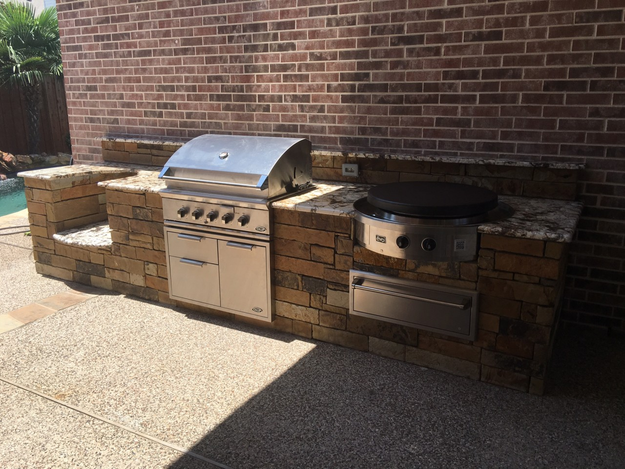 stacked stone outdoor kitchen narrow island kitchens and bbq 39s beautiful backyard living