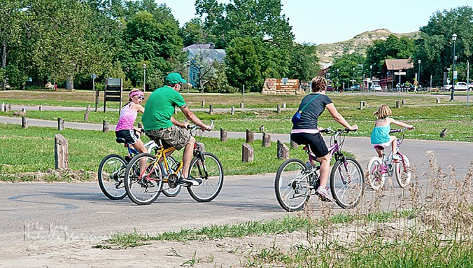 A family takes advantage of the paved bicycle trails around Medora and out in the country.