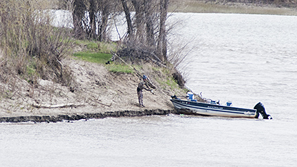 A lone fisherman on the banks of the confluence.