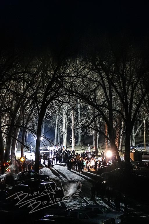 People gather under the trees in the lights at Sundheim Park at Fairview.